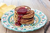Carrot and Orange Oat Flour Pancakes with berry sauce