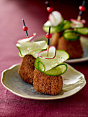 Goat's cheese croquette skewers with cucumber and radishes