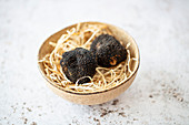 Two black winter truffles from Tuscany (Italy)