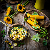 Pan fried courgettes with herbs and sliced almonds with sunflowers