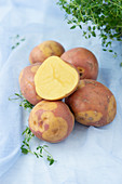 Several uncooked potatoes