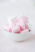 Marshmallow hearts in a bowl