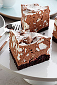 Cake with chocolate foam and pieces of meringue
