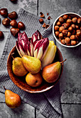 Treviso, chicory and pears in a bowl with chestnuts and nuts