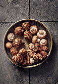 Jerusalem artichokes and mushrooms in a ceramic bowl