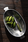 Cucumbers in metal bowl