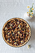 Tart with various berries and nuts