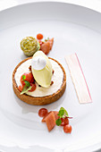 A rhubarb tartlet with woodruff ice cream and a macaroon