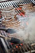 Game sausages à la Thuringia on a grill
