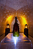 Champagne bottle in a chalk cellar, Champagne Ruinart, France