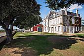 Main building and garden, Chateau Evangile, Pomerol, Bordeaux, France