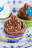 Cupcakes with chocolate frosting and love beads in colourful cuffs