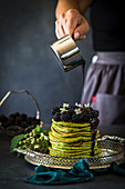 Spinach pancakes with blackberries and chocolate sauce