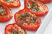 Oven-roasted tomatoes with honey and herbs