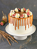 Apple and fig cake on a cake stand