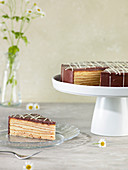 Baumkuchen (German layer cake) with one piece on a plate