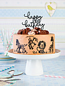 A children's birthday cake decorated with animals
