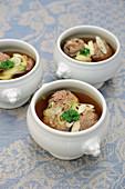 Venison liver dumpling soup in soup tureens