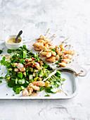 Japanese squid skewers with avocado salad