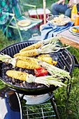 Barbecued corn toppers on grill