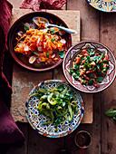 Bullhorn chilli salad, tomato and preserved lemon salad and radish and carrot salad (Morocco)