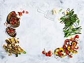 Different roasted vegetables on light surface