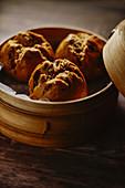 Jujubes bun in bamboo steamer