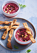 Hummus with beetroot and cheese sticks