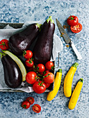Eggplants, tomatoes and yellow zucchinis