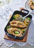 Horseshoe carp baked with potatoes and leeks