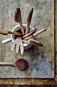 Wooden spoons and utensils in a porcelain jug