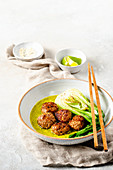 Meatballs with green curry with pak choi