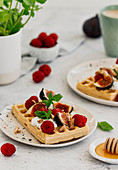 Honey waffles with raspberries, figs and cream