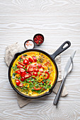 Italian healthy frittata with spinach, bell pepper and tomatoes