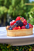 A tartlet with red berries and jelly
