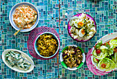 Coleslaw, Curried Cabbage, Potato Salad, (Wild spinach) Morogo, Green Salad, Bean salad