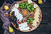 Cheese platter with grapes and figs