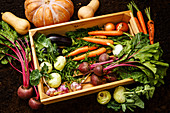 Healthy food Fresh raw vegetables in wooden box on black ground background
