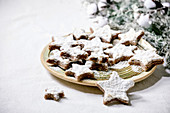 Homemade star shape cocoa almond cookies with white glaze and icing sugar