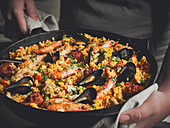 Paella in a cast iron pan