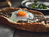 Pide with minced meat and egg