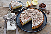Vegan apple and caramel tart with coconut cream