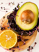 Half an avocado, red cress and half a lemon