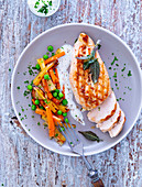 Chicken breast fillet with sage served with spring vegetables and a dip
