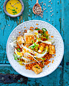 Lentil salad with fennel, tofu and orange sauce