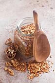 A jar of homemade roasted muesli with walnuts