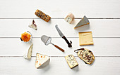 Various cheeses with a slicer and a cheese knife