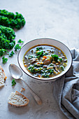 Mushroom and pearl barley broth with kale leaves