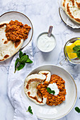 Indian lentil dhal with mint yoghurt and pita bread