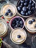 Lemon mugcake in a glass with blueberries